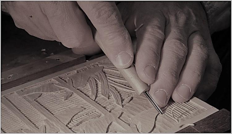 talla de madera La Restauradora